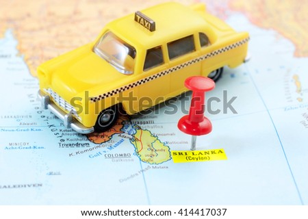 Close up of  Sri Lanka Ceylon  map with red pin and a taxi  toy - travel concept