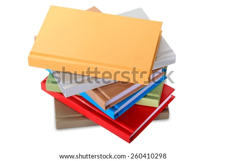 close up of stack of colorful books on white background. - stock photo