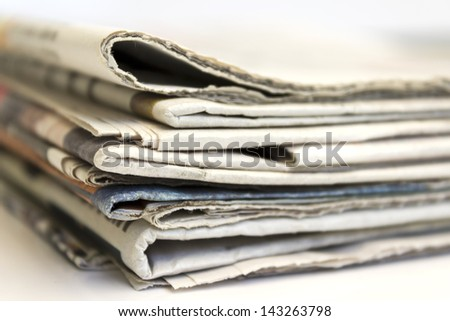 Close up of stack of newspaper - stock photo