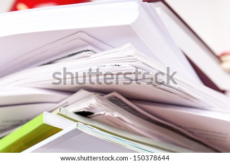 Close up of stack of old paper files