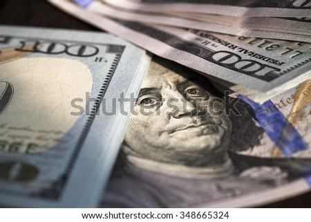 Close up of stack of one hundred dollar bills. - stock photo