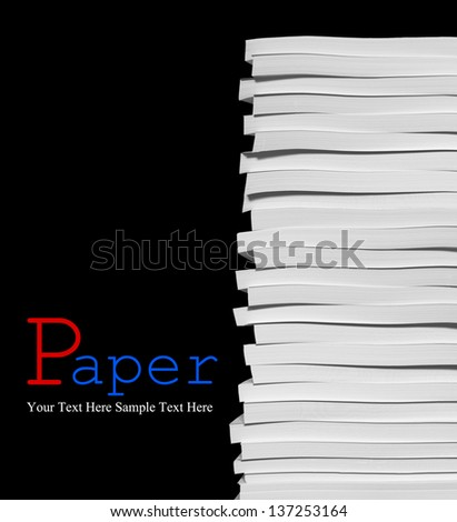 Close up of stack of papers on black background - stock photo