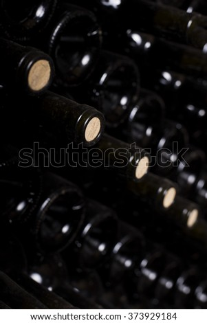 Close up of stacked up wine bottles in the old cellar