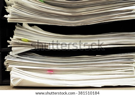 close up of stacking documents in office table