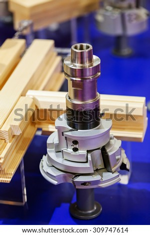 close up of stainless steel and aluminum  woodworking machine