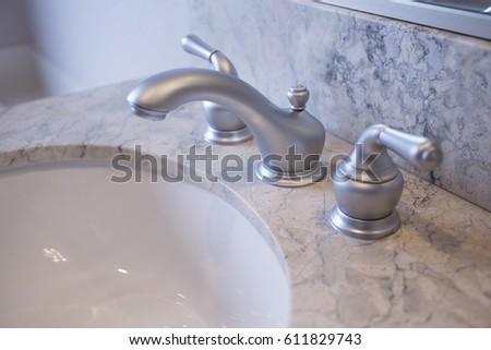 stainless steel bathroom fixtures. Close Up Of Stainless Steel Bathroom Faucet And Marble Counters Fixtures