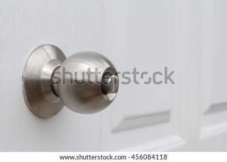 Close up of stainless steel round ball door knob - stock photo