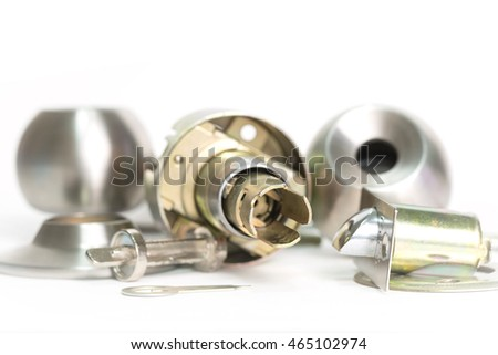 Close up of stainless steel round ball door knob components isolated on white background as Locksmith concept.