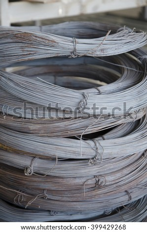 Close-up of stainless steel wire coils in warehouse  - stock photo