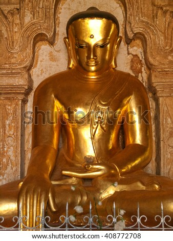 Close up of statue of Bhudda in earth-touching mudra. Frontal view. Photo taken in Ananda Temple, Bagan, Myanmar. (All temples in Myanmar are public space and free to visit.)