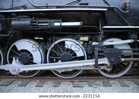 Close-up of steam train wheels at Travel Town museum, Los Angeles - stock photo