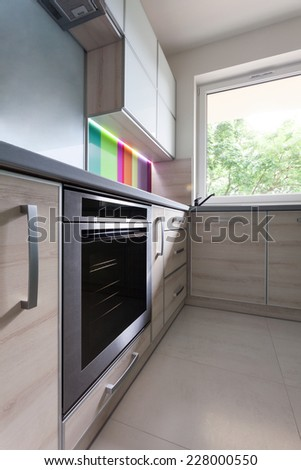 Close up of steel oven in modern kitchen - stock photo
