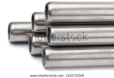 Close up of steel pipes on white background - stock photo