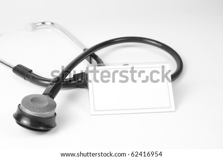 Close-up of stethoscope and blank business card