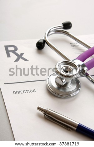 Close-up of stethoscope and prescription form isolated - stock photo
