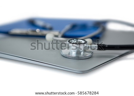 Close-up of stethoscope on laptop on white background