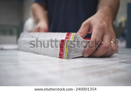 close up of stitched paperback binding - stock photo