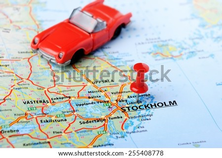 Close up of Stockholm ,Sweden map with red pin and cabrio car - Travel concept  - stock photo