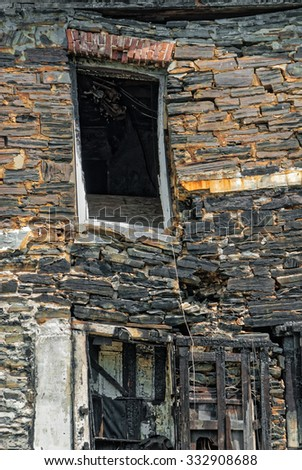 Close up of Stone Building Destroyed by Fire - stock photo