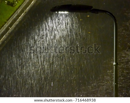 Close up of street light with torrential rain