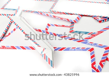 Close up of striped Air Mail envelopes  with paper plane on the side