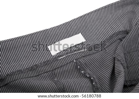 close-up of striped fabric and blank tag - stock photo