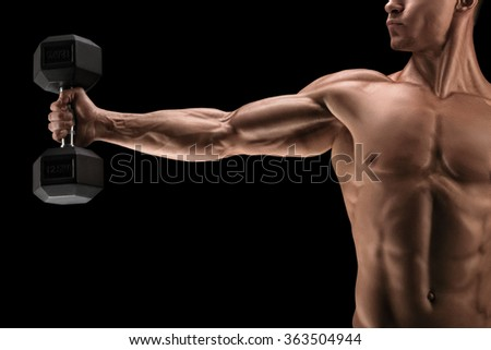 Close-up of strong bodybuilder with six pack, perfect abs, shoulders, biceps, triceps and chest, deltoids muscle. - stock photo