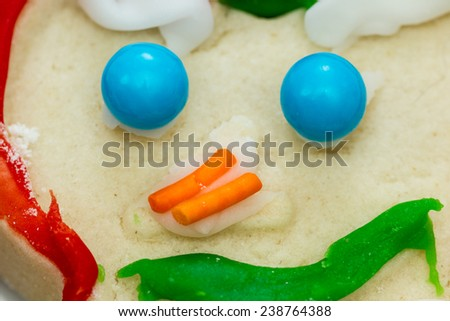 close up of sugar balls and sprinkles used to decorate holiday cookies