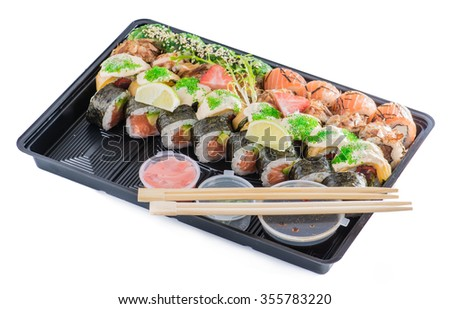 close-up of sushi roll in the black box, Sushi delivery. shallow DOF - stock photo