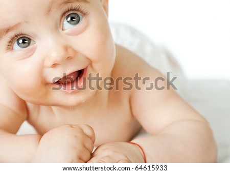 Close-up of sweet little baby face, smiling and looking up, copyspace