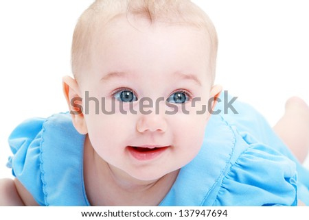 Close-up of sweet little baby girl in blue dress isolated over white - stock photo