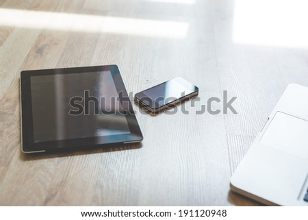 close up of tablet and smart phone on the floor at home - stock photo
