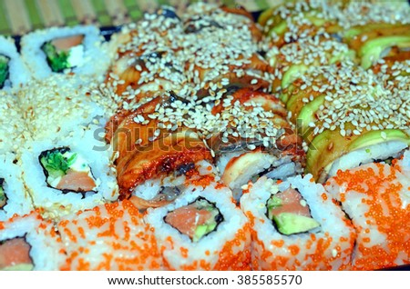Close up of tasty fresh sushi rolls on plate