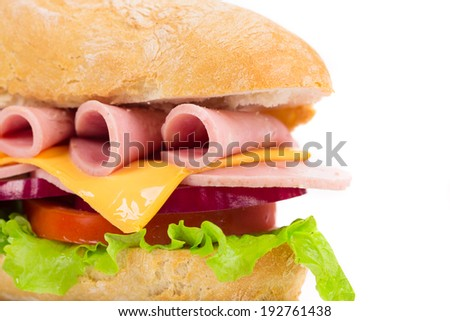Close up of tasty sandwich with ham and tomatoes. Whole background. - stock photo