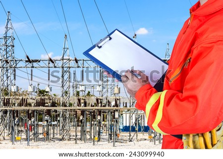 Close-up of technician maintaining record at power plant - stock photo
