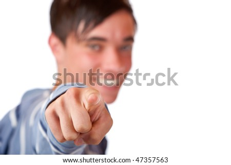 Close-up of teenager pointing with finger on camera. Isolated on white.