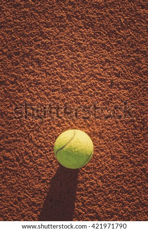 Close up of tennis ball. green color tennis bal on a tennis court. - stock photo