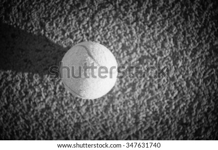 Close up of tennis ball on clay court./Tennis ball , black and white - stock photo
