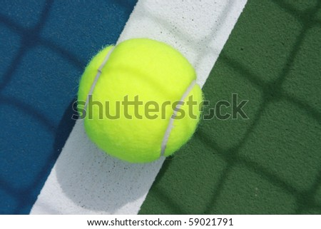 close up of tennis ball on the boundary line - stock photo