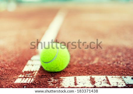 close-up of tennis ball on the court - stock photo