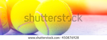 Close up of tennis ball with color filters - stock photo