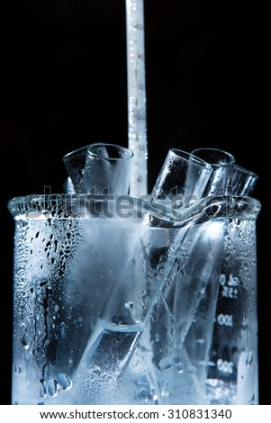 Close-up of test tubes in a hot beaker. - stock photo