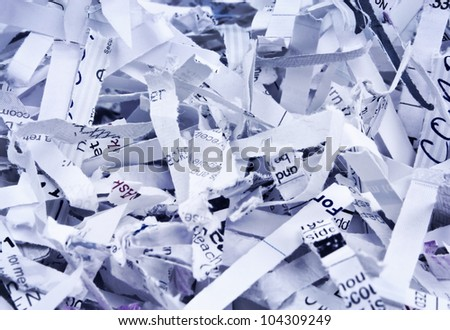 Close up of textured heap of shredded confidential papers with blue overlay with copy space.