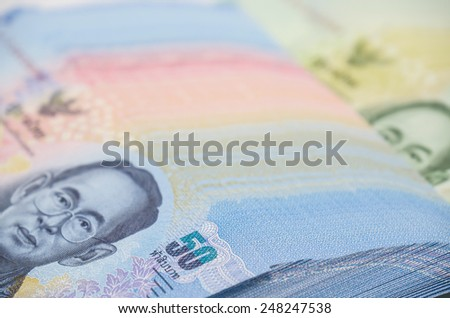 Close up of thai banknotes or bills for trading, buying, currency exchange or investment business background