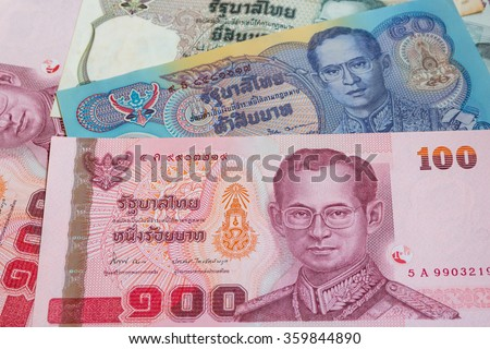 close up of thai money 20, 50, 100 baht on background