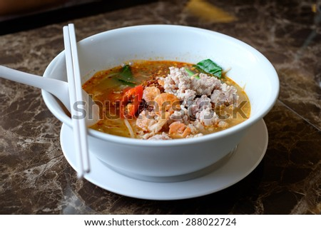 Close up of Thai Spicy noodle soup in a bowl (Tom Yam)