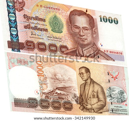 Close up of thailand currency isolated on white with Clipping Path. Denomination of 1000 bahts. - stock photo