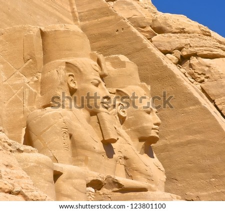 Close-Up of the Abu Simbel monument showinp statue of Rameses II in Egypt - stock photo