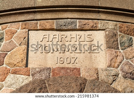 Close-up of the ancient sign of the tower of Aarhus in Denmark - stock photo