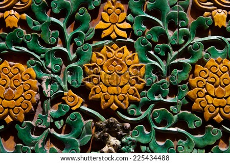 Close up of the Beautiful Coloured Glaze Lotus on the Wall of Forbidden City - stock photo